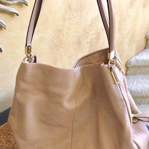 Tan leather roomy Coach bag